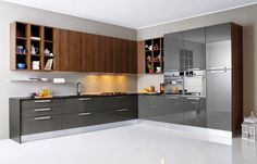 Our modular kitchens are completely factory manufactured with top of the line imported machines and hence have superior finishes and durability. As per the design each kitchen cabinets are manufactured with precision. Wooden Countertops, Pictures Of Kitchen Islands, Floor To Ceiling Cabinets, Modern Kitchen Cabinets, Moduler Kitchen, Kitchen Pics, Kitchen Ideas, Steel Doors, Kitchens