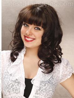 A shoulder length curly haircut with a fringe/bangs spring 2012