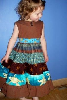 I have received a few requests to explain how to a simple tiered twirl skirt. The patchwork skirt uses the same method, but here are the dis...