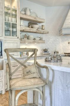 French Farmhouse Style - driftwood finish on cabinetry & thick, open shelves