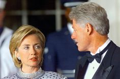 President Bill Clinton and First Lady Hillary Clinton talk prior to the arrival of Czech Republic President Vaclav Havel for the official State Dinner at the White House in Washington, DC, September 16, 1998. (Stephen Jaffe/AFP/Getty Images)