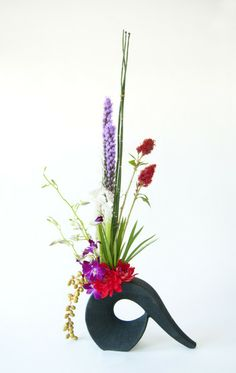strong and tall with celosia, fig, orchids, equisetum, liatris, saracena, dahlias and papyrus JP Parker Flowers