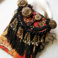 http://www.flickr.com/photos/cindycaraway/5579802520/  Gypsy Evening Bag - Fringe and Floral Purse