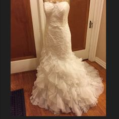 """Galena Signature wedding gown w/petticoat Galena Signature wedding gown Size 12. I had a few alterations made. At the time I was a 38DD size 12 pants/jeans and I am 5""""8. Laying the dress down flat the bust is 18.5 inches, under bust is 16 inches, waist is 17 inches & hips is 19 inches. COLOR: soft white. It also has 3 hooks for the bustle. Comes with petticoat also. Size 12 Galina signature Dresses Strapless"""