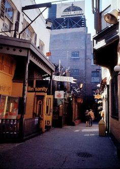 Piper's Alley (Old Town) as it appeared in 1968, Chicago. When it was an actual alley! Now replaced with the movie theater and retail complex. Second City also has their theater here.