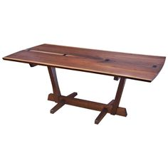 Elegantly Figured Conoid Dining Table by George Nakashima, 1975. American black walnut 2-board book-matched table with free sap edges and 4 rosewood butterflies