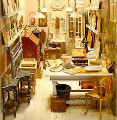 Love the crowded space bursting with an abundance of painted canvases. Tom Roberts?