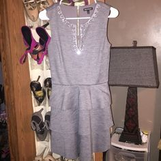 Juice couture dress size 2 Super cute grey dress... Has silver and rhinestone around the neck line... In great condition Juicy Couture Dresses Midi
