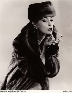 Barbara Mullen by William Klein, Paris, 1956. I love this--putting lipstick on with a brush while smoking a cigarette