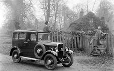 Kitty Brunell, daughter of photographer Bill Brunell, waves off a companion standing on her Singer Junior Saloon Eight