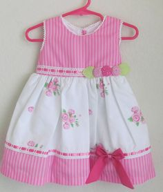 Perfect for those days in the park, the combination of tones and stamps makes this perfect for an everyday look. - pink mini roses and two tone pink stripes cot. Frocks For Girls, Kids Frocks, Little Girl Dresses, Girls Dresses, Toddler Dress, Toddler Outfits, Kids Outfits, Couture Bb, Girls Frock Design