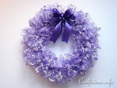 This fluffy wreath for the spring is incredibly easy to make. Organza fabric was used to create it and gives a light and airy feeling to it. If the color lilac/ purple is not your color, any color organza fabric will work for this project. Wreath Crafts, Diy Wreath, Wreath Ideas, Holiday Wreaths, Christmas Decorations, Holiday Crafts, Purple Wreath, Floral Wreath, Fabric Wreath