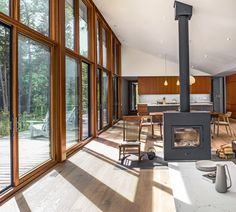 Large south-facing windows by Loewen and a high-efficiency Rais X wood-burning stove help to reduce energy demands.