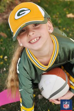 Let her put her best foot forward in her Green Bay Packers gear. (via Housewife Electric)