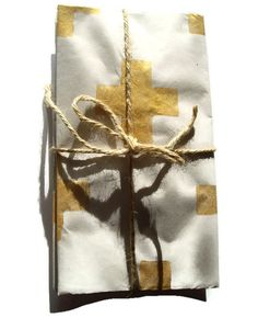 Hey, I found this really awesome Etsy listing at https://www.etsy.com/listing/159837780/gold-swiss-cross-gift-wrap