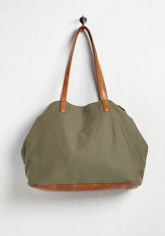 Move Mountaineer Bag. Styling for your summit excursion is easy to come by after slipping the faux-leather straps of this canvas bag over your shoulder. #green #modcloth