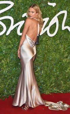 How low can you go Karlie Kloss? The model looks like a total bombshell at the British Fashion Awards!