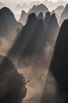 Through - Another shot of sunlight coming through mountains of Guilin, China, by Kyon J... #trees #sky #sunrise #morning #forest #mountains #water #boat #river #travel #sun #sunlight #light #clouds #mountain #rays #China #Guilin