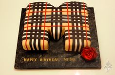 - Letter M Burberry shaped cake