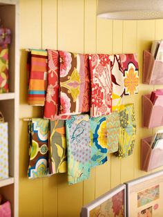 Mount cafe rods on a wall or the side of a cabinet to make great hangers for fat quarters. Organize fabric by color or by designer to make finding the perfect piece a breeze.