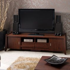 Anchor your entertainment space in effortless style with this essential design, perfect in the den or living room.
