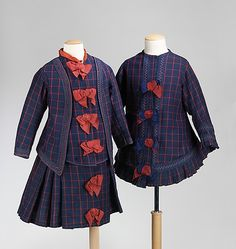 Girl's red and blue wool ensemble with silk ribbon trim, American, 1876. The complete four-piece ensemble, seen here, is rare for children's clothing. This piece is a good representation of high style childrenswear from the 1870s. The whimsical detail in combination of red and blue ribbon trim on the coat, defines the coat as a separate piece of outerwear from the other parts of the ensemble. It is very possible that the bodice and jacket are alternative bodices for the skirt.