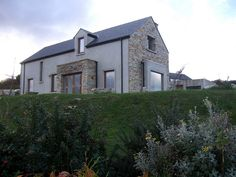 a simple vernacular style house finished with slate stone and render www. House Designs Ireland, Outside Paint, Slate Stone, Dream House Interior, Bungalow House Design, Traditional Exterior, House On A Hill, Donegal, House Plans