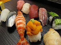 Loves him some sushi...
