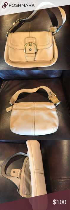 """Coach Soho Pocket Flap Satchel Bag Coach beige pebbled leather features gold toned hardware  buckle accent on front  rear flat pocket w/ magnetic snap closure  interior lined in satin  single zipper pocket inside as well as accessory pocket and D-ring  Made in China  10"""" drop  Serial # M0769-11842 In EUC a little marking under the strap is seen in photo Coach Bags Satchels"""