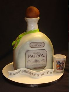 Patron tequila - This was so cool, fun and easy to do... it is all fondant , air brushed with edible images for the labels.  I love my edible printer :)  TFL