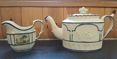 """White stoneware Castleford type teapot and a creamer c.1800   white stoneware teapot and lid in great condition (just a mark under base) with applied classical figures in the Castleford style. Impressed 20. Also for sale is a Castleford type painted cream jug which as a area of professional restoration to one side at the rim. This is impressed 36.  tiny flea scrap to footrim one on sideof handleTeapot5.5"""" jug 3.7"""" £93"""