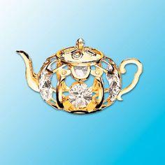 Golden Teapot Suncatcher -Swarovski Crystal Elements  --  Teapots! Every kitchen needs one that boils water and one for the window! This suncatcher teapot is fashioned in gleaming 24k gold plated finish and accented with clear Swarovski crystal elements. It's gonna glow! Turn your teapot into a magnet with our optional magnet adapter. So easy.