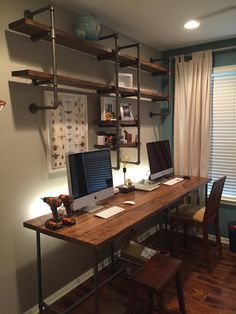I like the shelves here with the filing cabinet desk