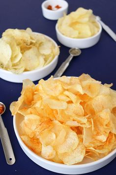 "Homemade Potato Chips ""Homemade Potato Chips"", my attempt to make the perfectly crispy potato chips easily at home. Flavored with black pepper or red chilli powder, it is perfectly spicy and seasoned for my taste buds. Potato Chips Homemade, Fried Potato Chips, Home Made Potato Chips, Crispy Chips, Snack Recipes, Cooking Recipes, Skillet Recipes, Cooking Tools, Cooking Gadgets"