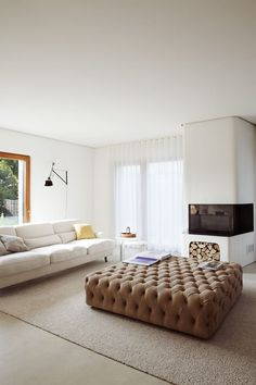 Pouf Capitonne ottoman and Raffles sofa by DePadova, both available at SUITENY.COM