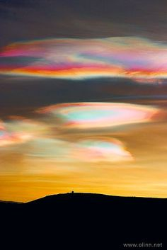 Nacreous Clouds. Nacreous clouds are also known as polar stratospheric clouds (PSCs), and can be seen in the polar countries of the northern and southern hemisphere at altitudes of 15,000–25,000 meters (49,000–82,000 ft). They are best observed during civil twilight when the sun is between 1 and 6 degrees below the horizon. They are implicated in the formation of ozone holes