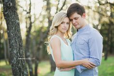 © Anna Lee Media | Oklahoma Engagement Photographer, couple pose, woods, chiffon mint green hi-low dress, outfit ideas