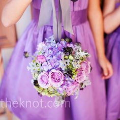 Purple Flower Girl Pomanders These colors might work perfectly with the pink and purple in the dress.