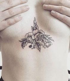 This simple flower sternum tattoo is hidden and lovely!