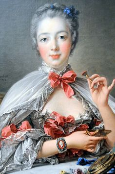 This is a painting by Francois Boucher titled The Marquise de Pompadour. Boucher painted many portraits of Pompadour over several years. This painting, she was actually painted to look younger than she was. In this painting you can see the use of more pastel colors, and the more relaxed normal poses they started to use in the Rococo era. You can see she is also wearing a corset, and ruching on the sleeves.