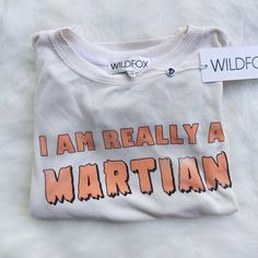"""•NWT• Wildfox I'm Really A Martian Sweater• New with tags.   →Size: XS  →Color/Design: """"I'm really a Martian"""" Cream Sweater →No trades (comments will politely be ignored).  →10% off 2+ items  Wildfox Sweaters"""