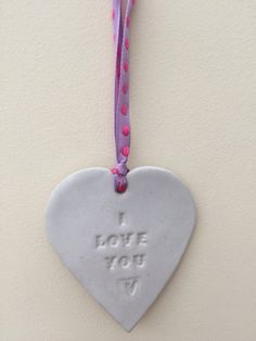 A personal favourite from my Etsy shop https://www.etsy.com/uk/listing/286039489/loveheart-hanger-gift-idea-pottery-one