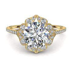 Bague de fiançailles solitaire diamant rond de 1,60 carats or jaune Arina  Arina, belle bague de fiançailles diamant rond or jaune de 1,60 carats. Cette bague diamant or jaune est sertie d'un diamant central de 1 carat. La particularité de ce bijou est son plateau sertie de diamants de différente tailles et qui lui donne un aspect tout à fait unique. Cette belle bague de fiançailles diamant que nous fabriquons dans nos ateliers est montée sur de l'or blanc, jaune ou rose 18 carats selon…