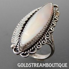 VINTAGE NAVAJO STERLING SILVER MARQUISE MOTHER OF PEARL FEATHER ELONGA – Gold Stream Boutique