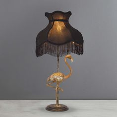 Featuring a detailed posing flamingo, this antique brass table lamp offers a black faux silk shade with a tasselled finish and gold inner. Table Lamp Wood, Brass Table Lamps, Wood Lamps, Nightstand Lamp, Bedside Table Lamps, Retro Lampe, Living Room Decor, Bedroom Decor, Design Bedroom