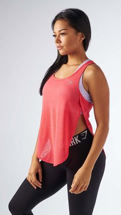 The Breeze Vest in sherbet pink is a workout top with a loose and liberating fit. With a high curved hem and lightweight, slubbed fabric blend, the Breeze Vest is as light as air.