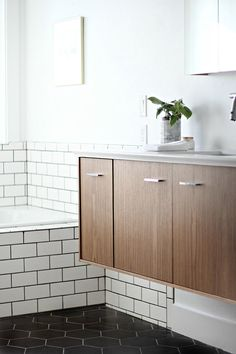 Before & After: A Modern Bathroom for a 1905 Farmhouse | Design*Sponge | Of Note: Floating Vanity!