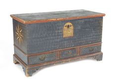 """Rare Adams County, Pennsylvania painted pine dower chest dated 1776, retaining its original blue sponge decoration with red moldings and a central tombstone cartouche, inscribed Rossina Orein Franklin Township Adams County Anno 1776, the sides with bold red, black, and white stars, 29"""" h., 48"""" w."""