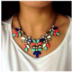coral mint neon floral statement necklace Beautiful neon coral mint! One of my best sellers! Like more jewelry pieces? All my jewelry is buy 2 get 1 free! Jewelry Necklaces