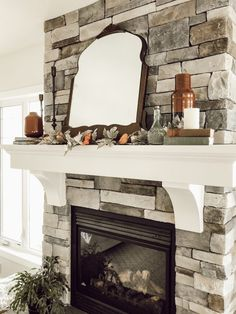 A mantel styled with a pop of rusty orange and vintage accents.  A Pop of Colour for Fall – Valley + Birch #falldecor #falldecorating #fall #mantel #fireplace #manteldecorating